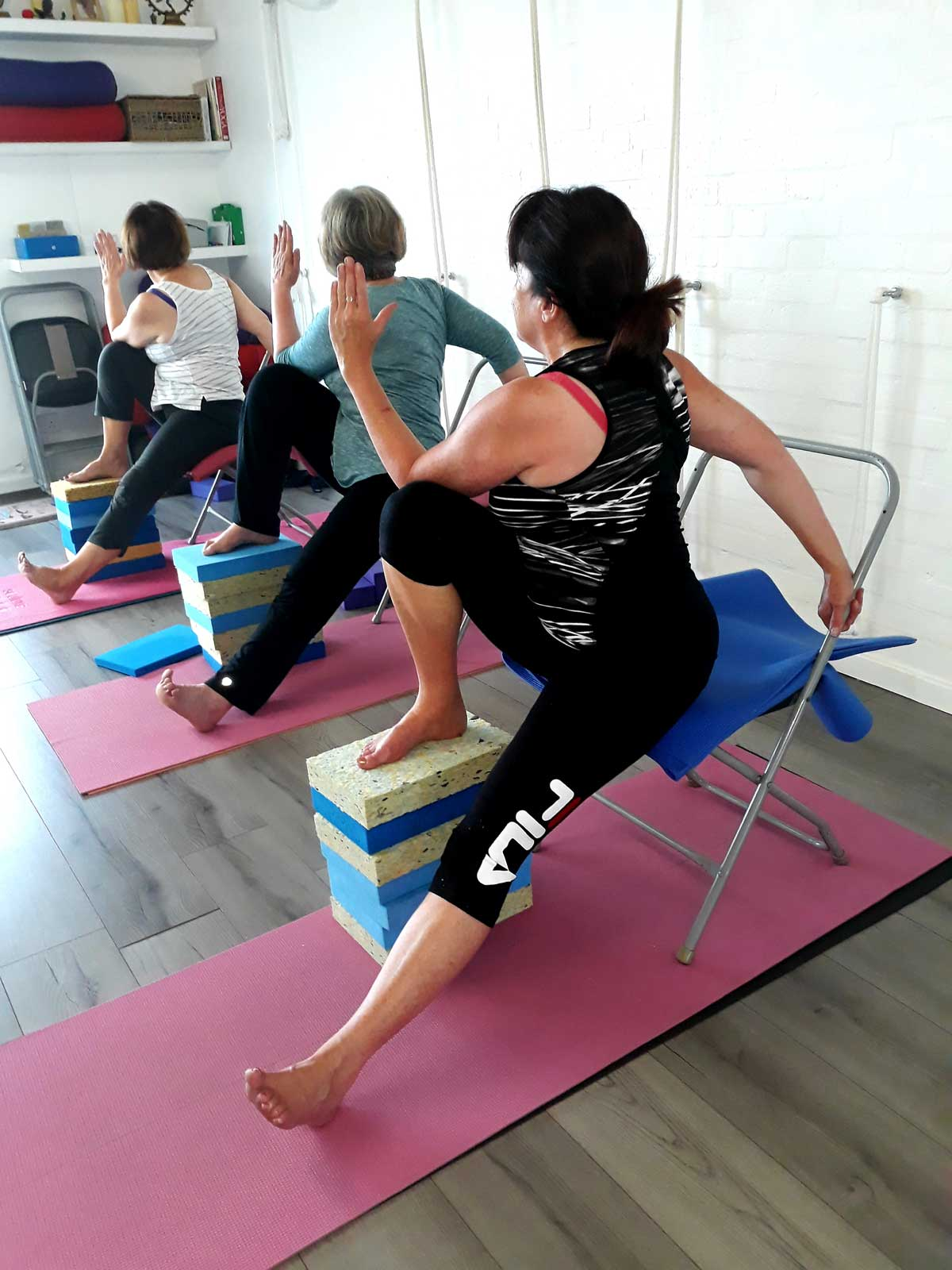 Working with chairs at Crescent Yoga Studio Lytham St Annes